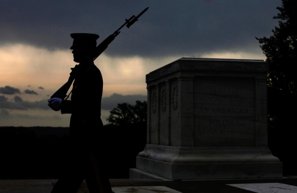 A soldier from the U.S. Army's Old Guard honor guard walks at the Tomb of the Unknowns at Arlington National Cemetery in Arlington