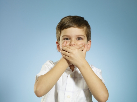 boy-covering-mouth