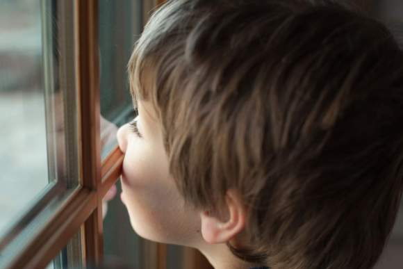 Children with divorced parents spend a lot of time waving from windows. It's sad. Put them first. Always. (Image/Time)