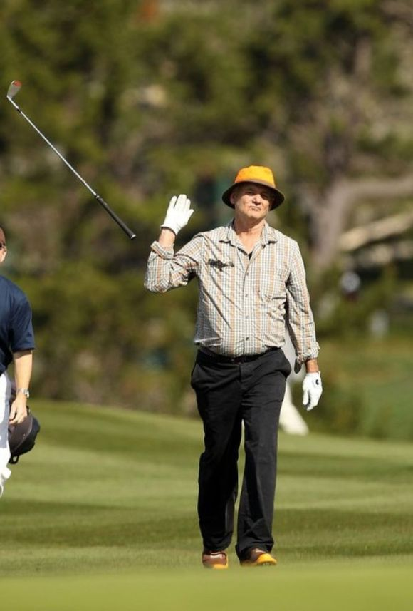 Bill Murray throws golf club