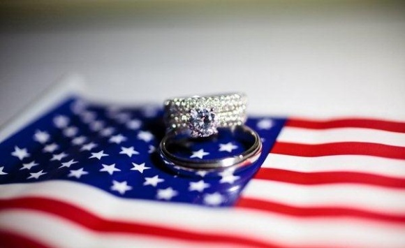 wedding rings on american flag