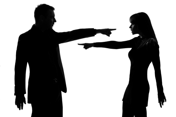 man and woman pointing fingers at each other