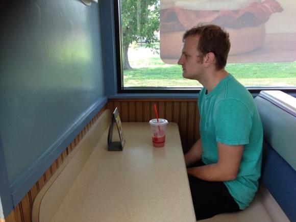 guy sitting alone at restaurant