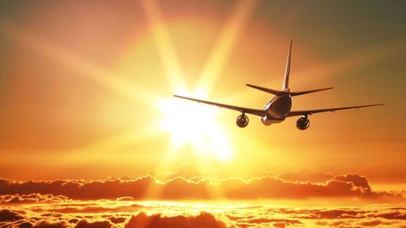 plane-is-taking-off-at-sunset